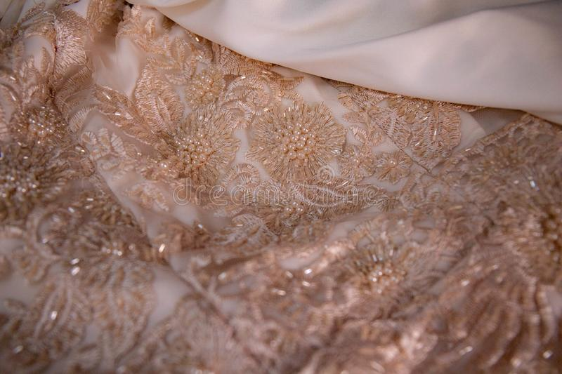 Beige and Ivory lace and bead work. Hand stitched beading. Fabric . Luxurious and wedding vibes royalty free stock photo