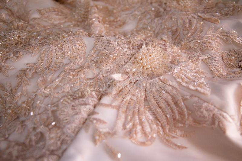 Beige and Ivory lace and bead work stock photos