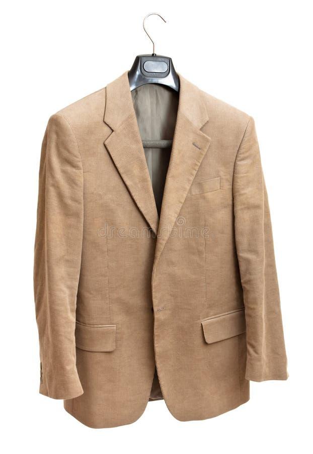 Beige jacket on hanger royalty free stock image