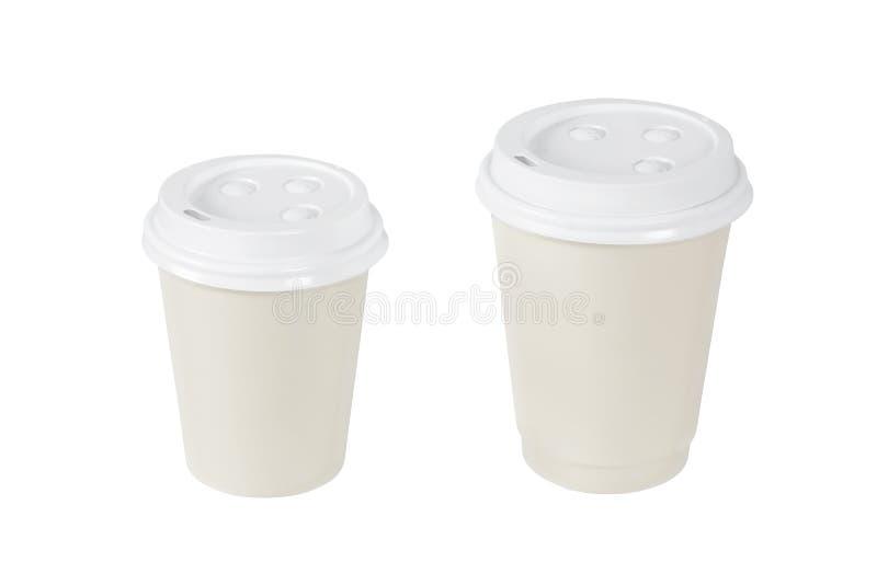 Beige Kaffeetassen lokalisiert stockfotos