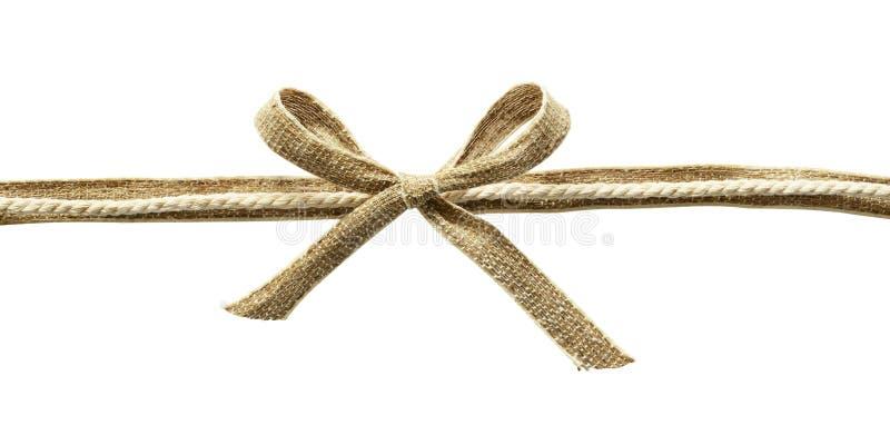 Beige kanfasband med repet och pilbågen royaltyfria foton