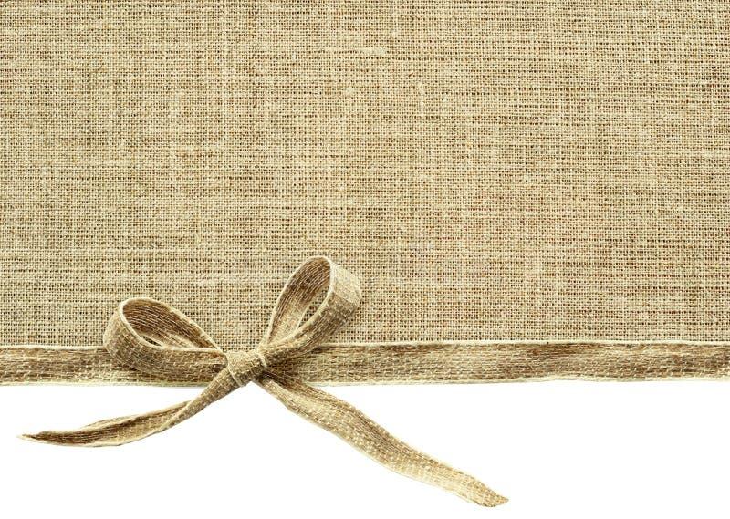 Beige kanfasbandpilbåge och textil royaltyfri fotografi