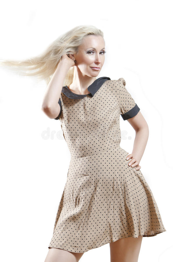 beige klänningflicka arkivfoto