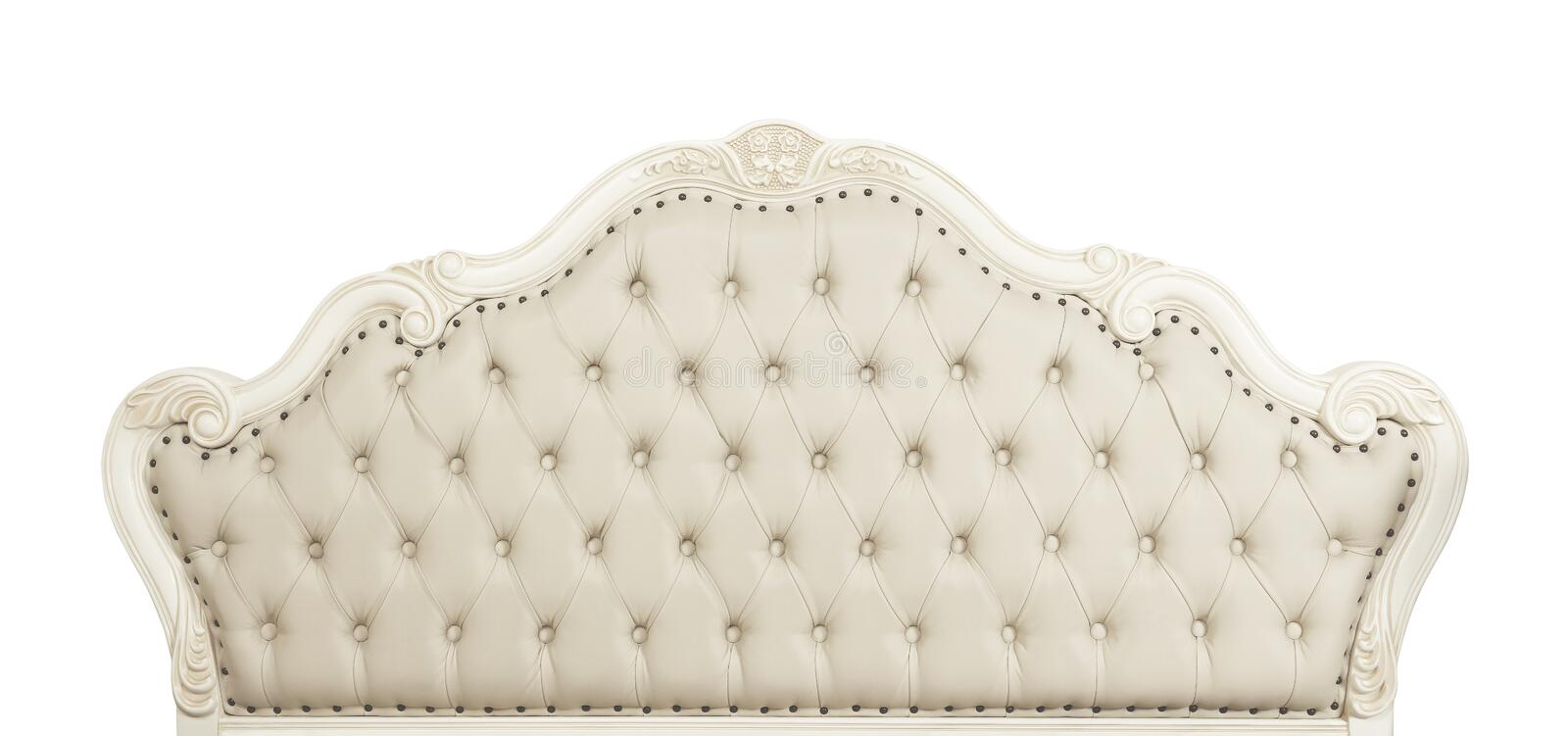 Beige leather bed headboard isolated on white royalty free stock image