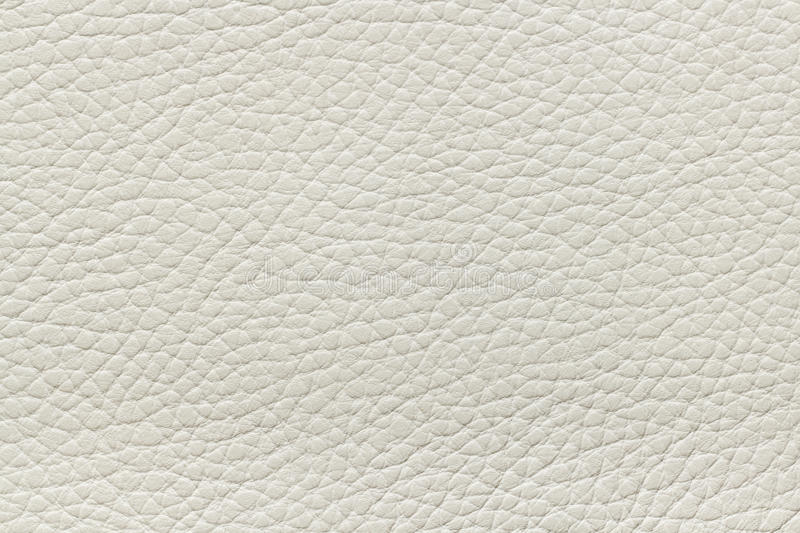 Beige leather texture. Macro shot of new beige leather texture stock images