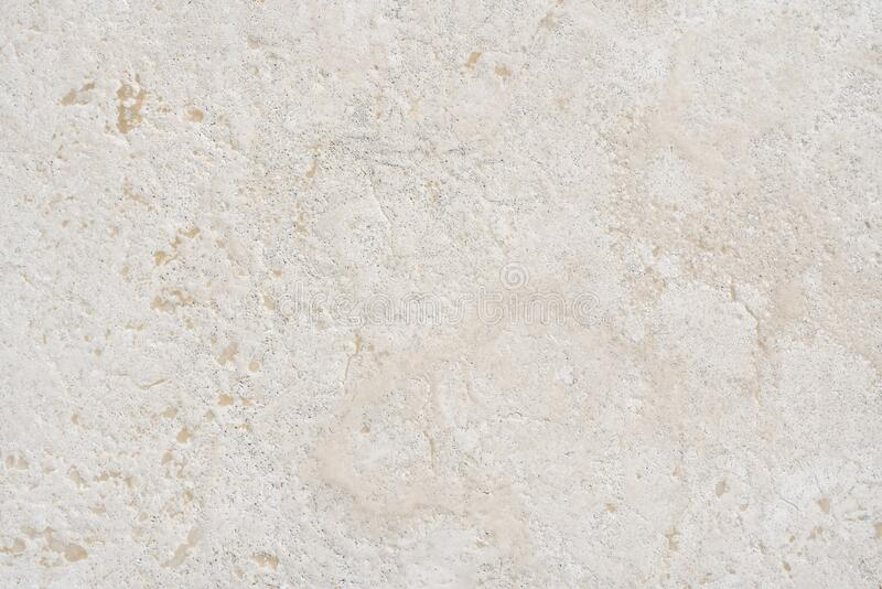 Beige limestone similar to marble natural surface or texture for floor or bathroom royalty free stock image