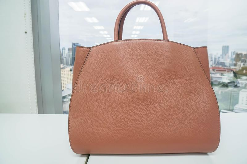 Beige luxury leather women bag for going to work. Close up beige luxury leather women bag for going to work stock photo