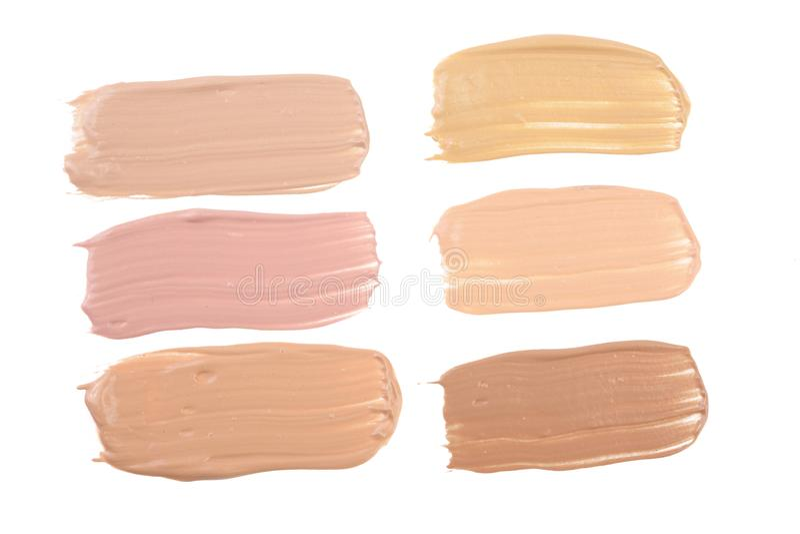 Beige Make-up der flüssigen Grundierung lokalisiert auf weißem Hintergrund lizenzfreie stockfotos
