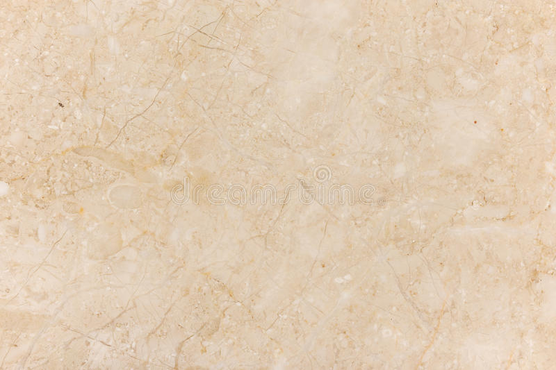 Beige marble with natural pattern. Marble stone wall texture. Beige marble with natural pattern royalty free stock photo