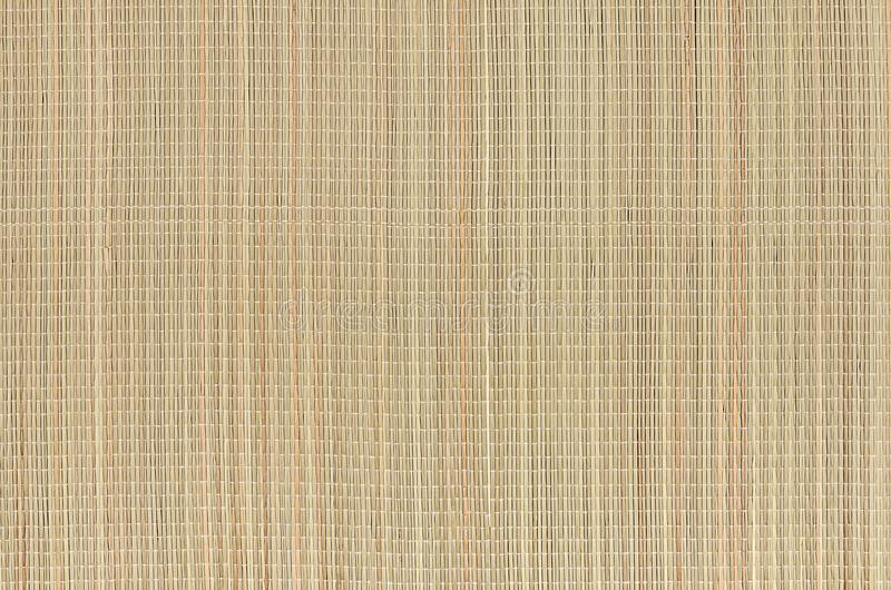 Beige natural mat of dry wicker grass as texture, background. stock images