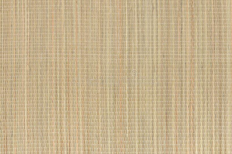 Beige natuurlijke mat van droog rieten gras als textuur, achtergrond stock afbeeldingen