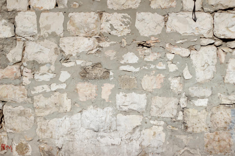 Beige old stone bricks wall texture. Wall built of Jerusalem stone blocks limestone Abstract background texture royalty free stock images