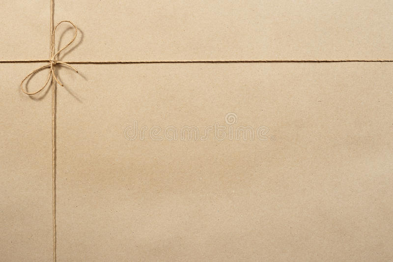 Beige packing paper, paper tied with a rope royalty free stock photo