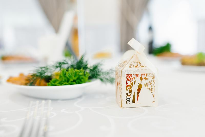 Beige paper box bonbonniere at the wedding royalty free stock photo