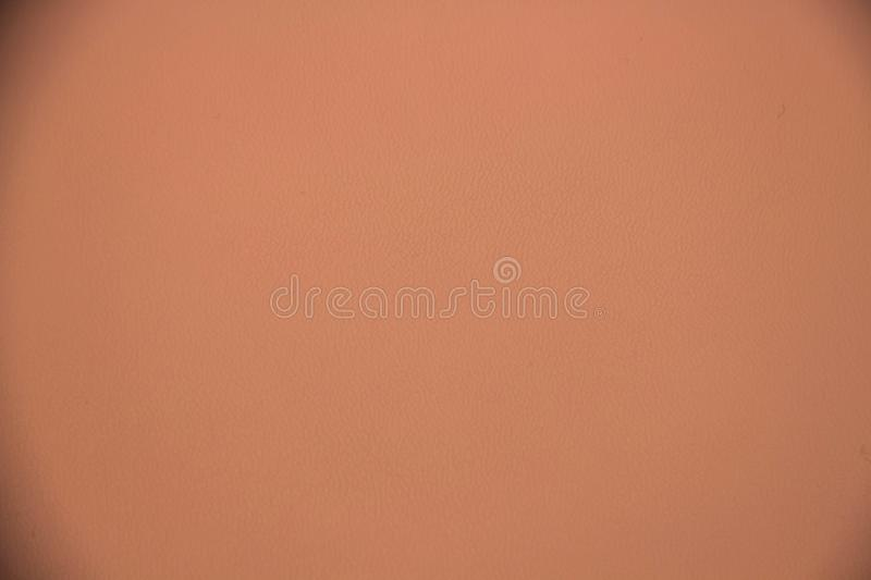 Light pink beige leather texture. Beige pink leather texture base closeup shot royalty free stock image