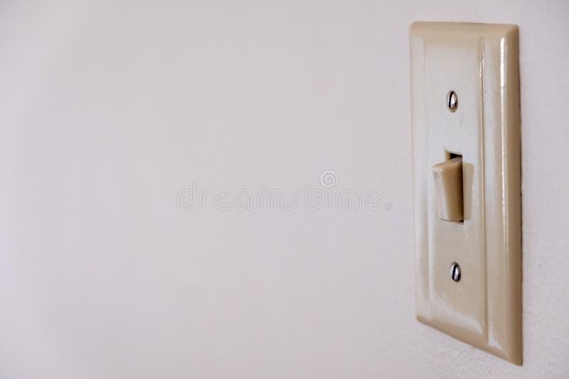 Beige, Plastic Lichte die Schakelaar van de Rechterkant wordt gefotografeerd stock afbeeldingen