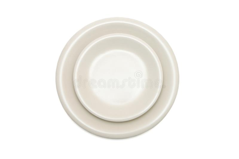 Beige Platte und Saucer getrennte Draufsicht lizenzfreies stockfoto