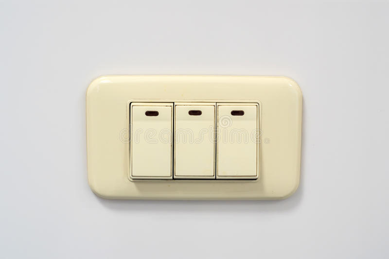 Beige Rocker Light Switch With Three Buttons Stock Photo - Image of ...