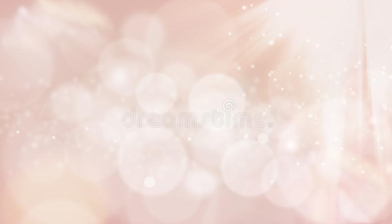 Beige sensual blurred background of lights. Bokeh and sun rays royalty free stock photo