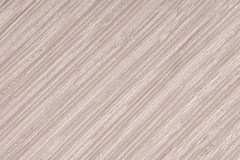 Beige shiny fabric with textures. Creative background royalty free stock photos