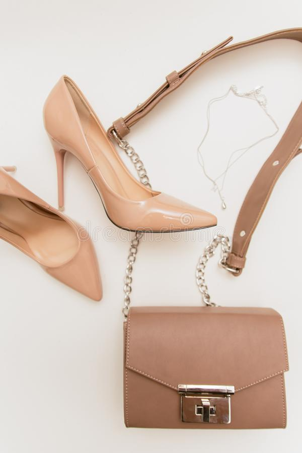 Beige shoes and bag on a light background royalty free stock photography