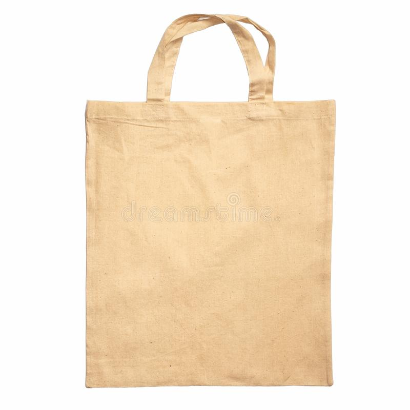 Beige shopping bag made of cotton fabric with handles isolated on white background royalty free stock image
