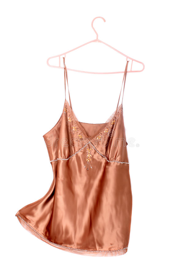 Beige silk top. Or camisole with jewels along the breast line stock images