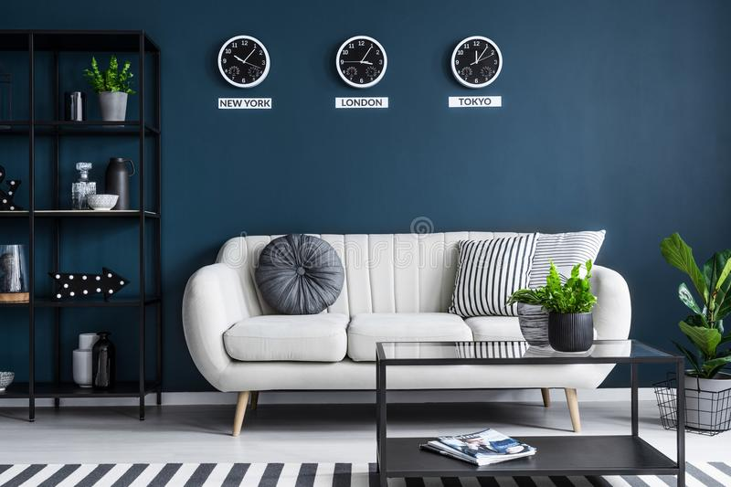 Beige sofa in dark interior royalty free stock photography
