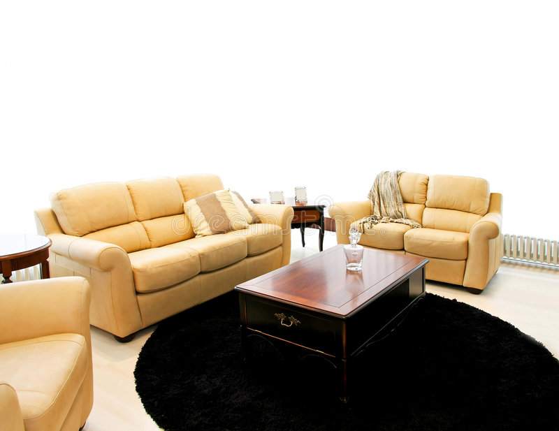 Beige sofas. Classic living room with beige leather sofas stock photography