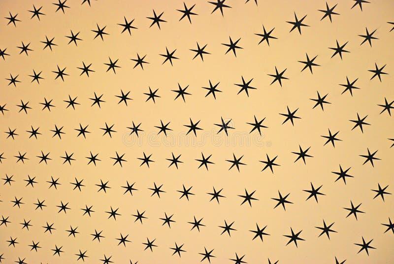Beige stjärnabakgrund royaltyfria foton