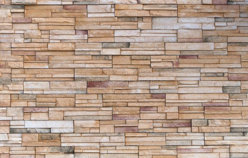 Beige stone brick block wall rock texture background stock image