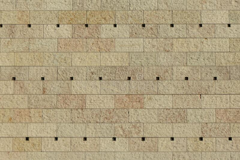 Beige stone wall background royalty free stock image