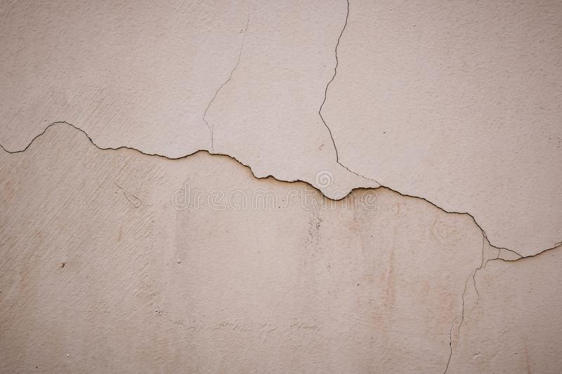 Beige stucco wall crackle surface. Light beige textured background. Grunge texture. Rough weathered backdrop royalty free stock photos