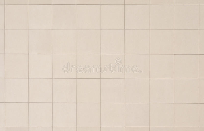 Beige tiled wall stock images