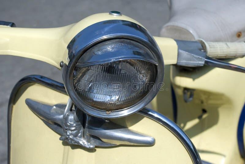 Beige vespa head light stock photo