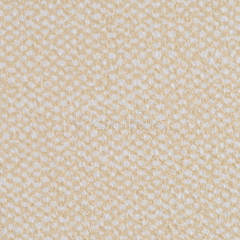 Beige vinyl texture. Embossed vinyl texture closeup texture background stock photo