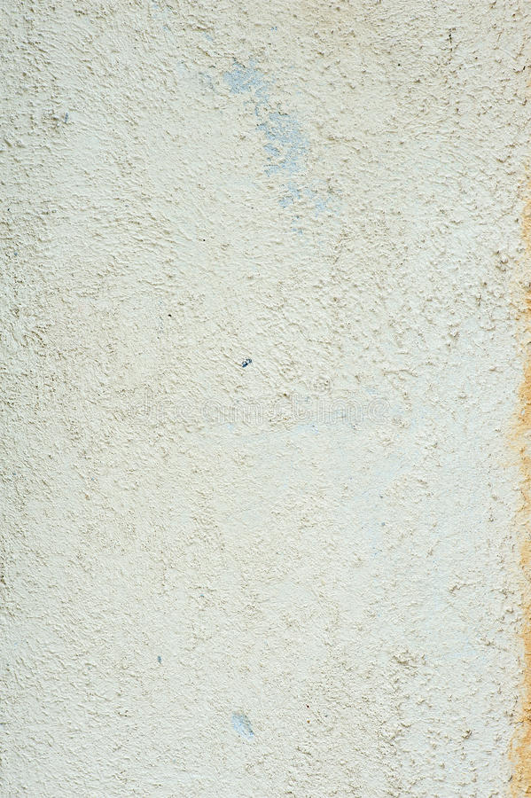 Beige wall texture. Beige roughly wall texture. Decorative plaster facade of the building. Old house facade royalty free stock photo