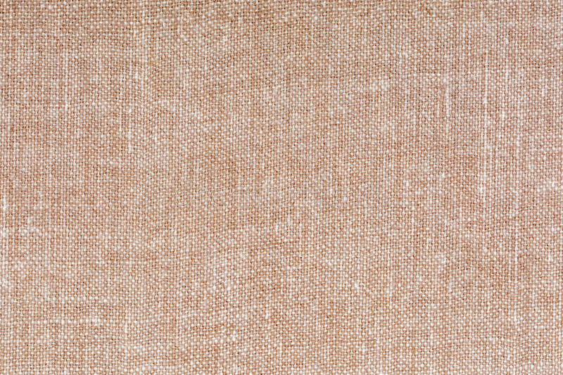 Beige and white decorative canvas fabric texture background, close up royalty free stock images