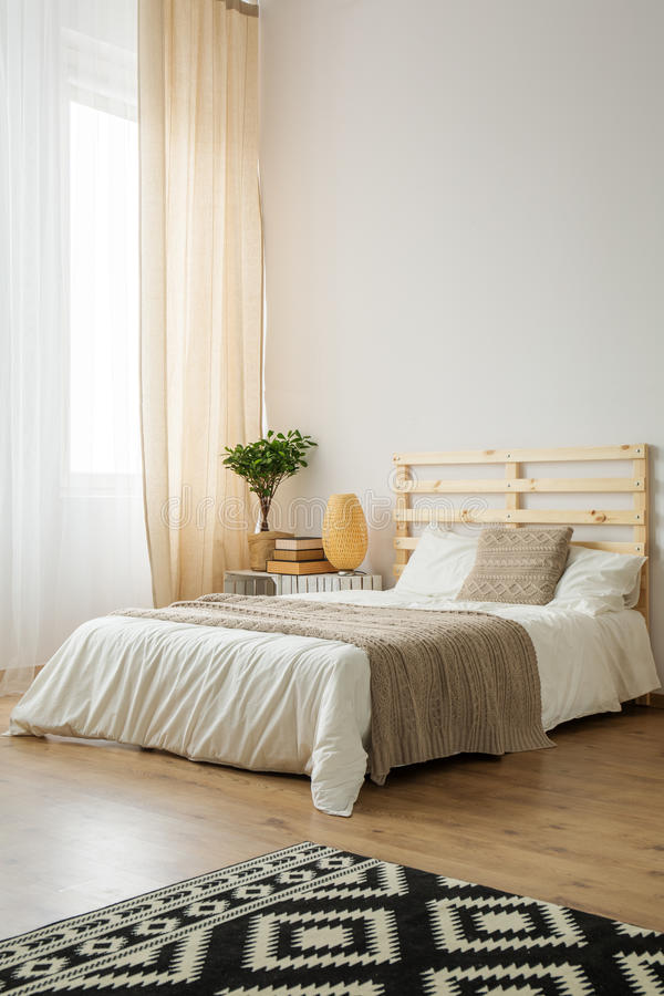 Beige and white minimalist bedroom royalty free stock photo