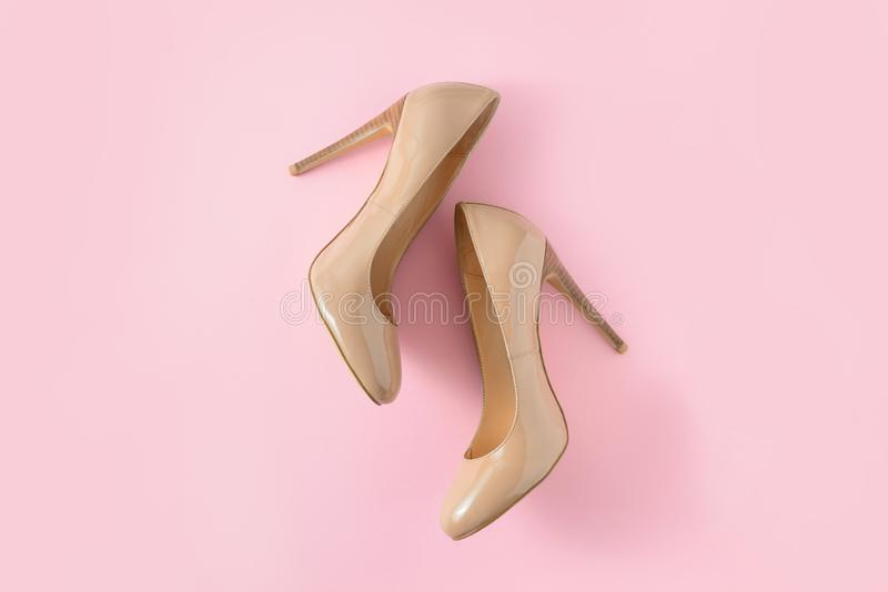Beige women high heel shoes on pink background. Fashion blog look. Top view, flat lay. Beige women high heel shoes on pink background. Fashion blog look royalty free stock image