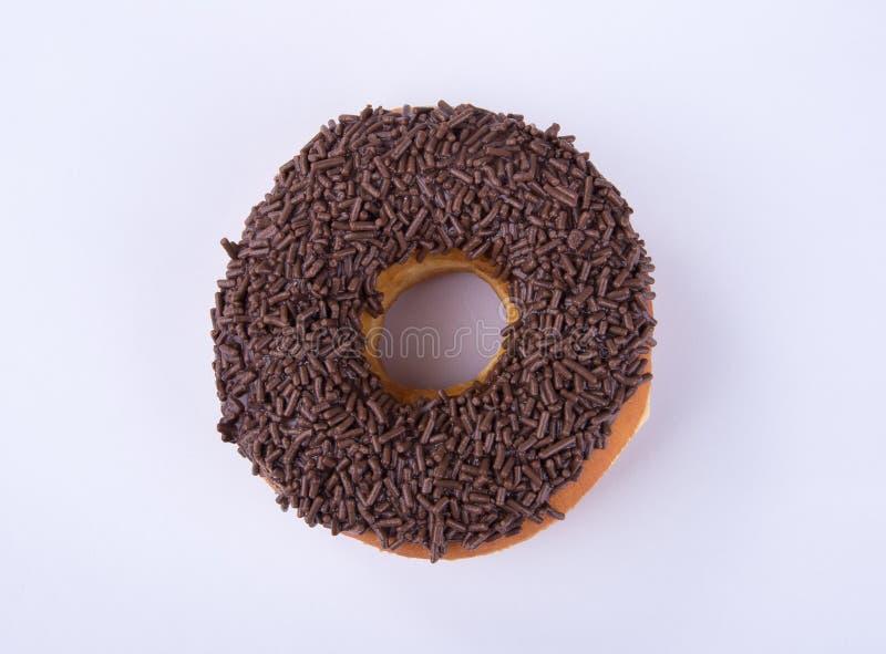 beignet ou beignet de chocolat sur un fond photos stock
