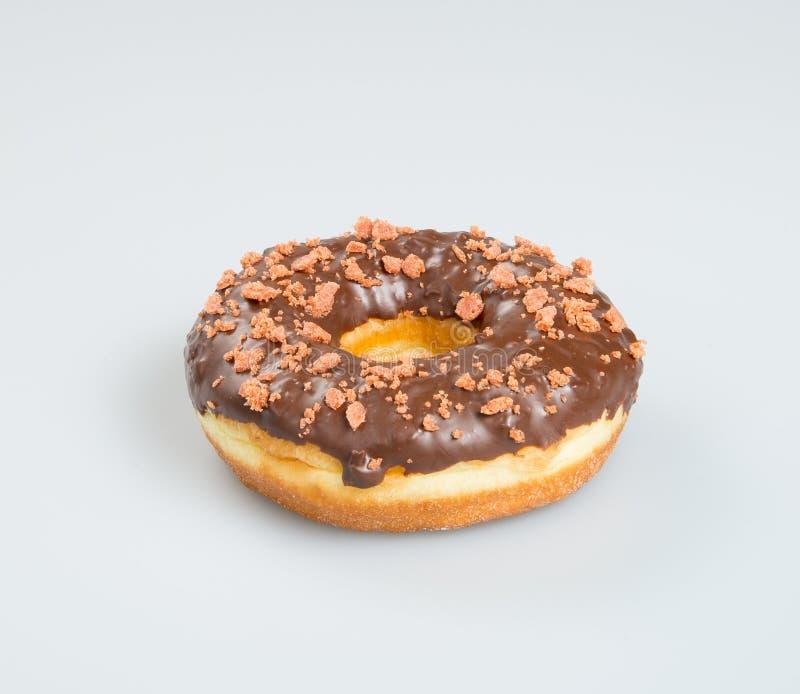 beignet ou beignet de chocolat sur un fond images libres de droits
