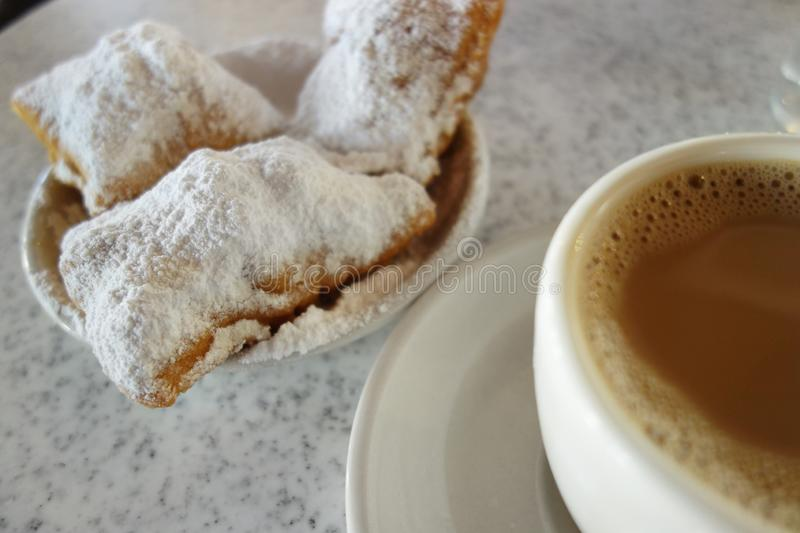 Beignets and chicory coffee in New Orleans royalty free stock photography