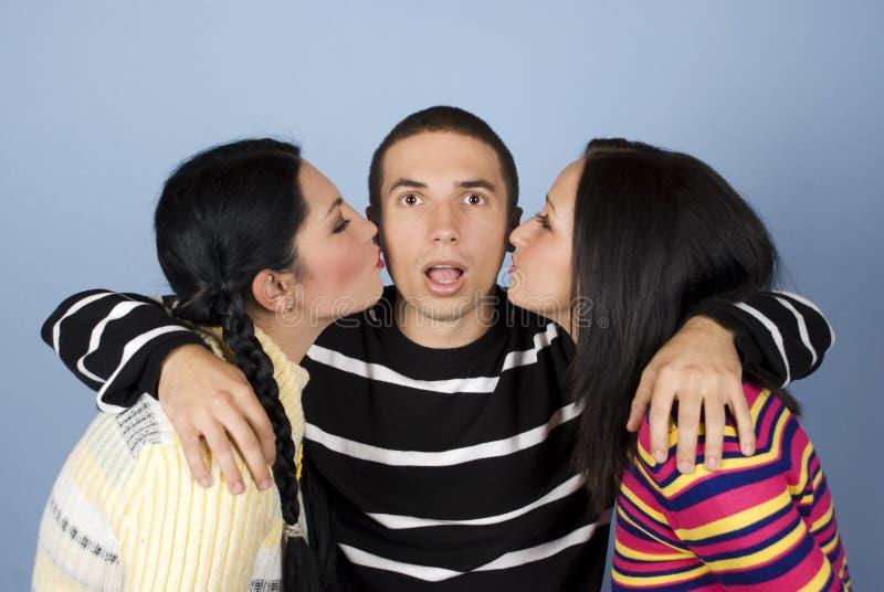 Beijado por duas mulheres imagens de stock