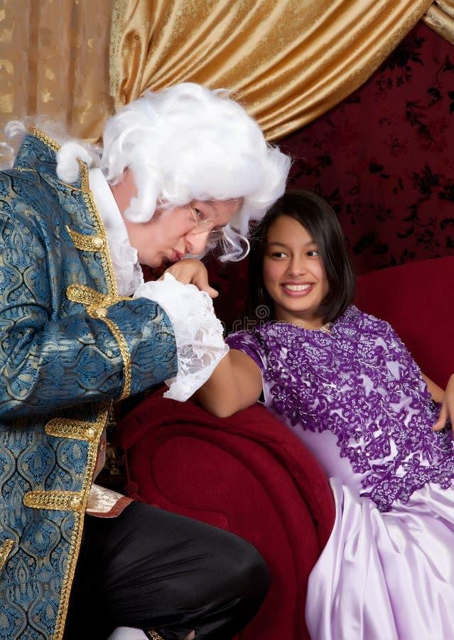 Beijando a mão fotografia de stock royalty free