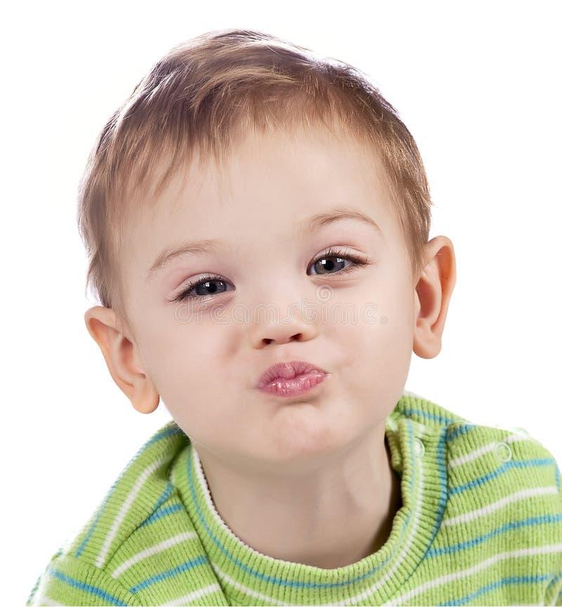 Beijando o bebé imagem de stock