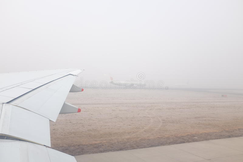 Beijing Air Pollution. A photo taken at Beijing Capital Airport on 20 December 2016 showed that the airport was shrouded by heavy smog with API higher than 400 stock photography