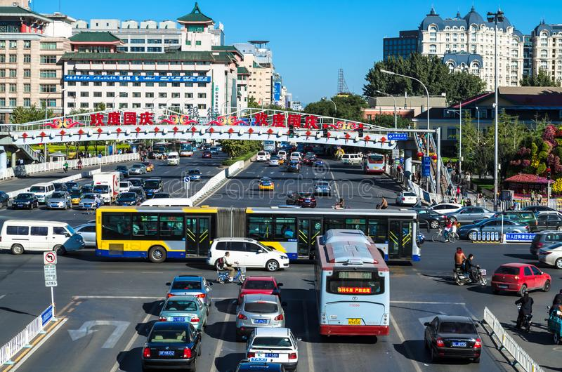 BEIJING, CHINA – October 15, 2013: Panoramic view of one of the central streets of Beijing. In the foreground: intersection with a busy traffic, in the stock photography