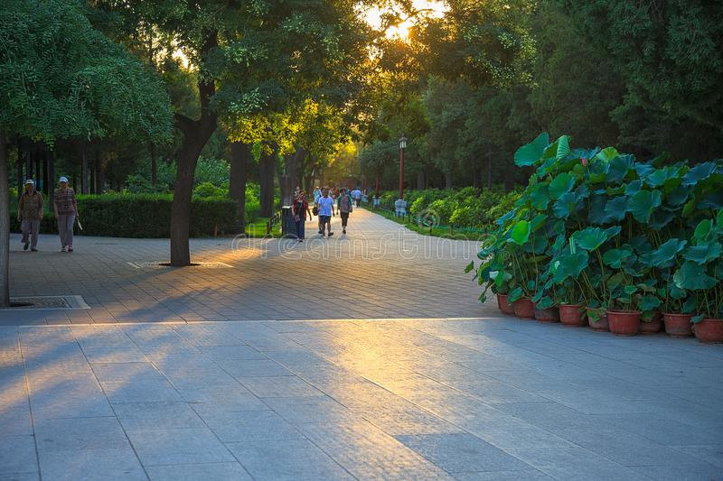 People walking in Jingshan Park, Beijing, China royalty free stock images