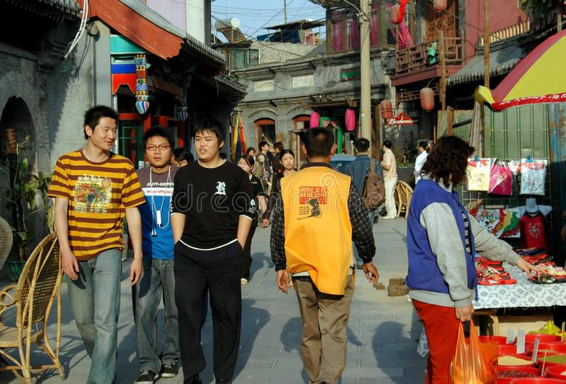 Beijing, China: Busy Hutong Street. A bustling street lined with shops and centuries old buildings attracts people to the Shi Sa Hai Hutong in Beijing, China stock image